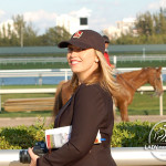 Trixie cheering on the contenders in the 2013 Palm Beach Stakes wearing a Dewey Square hat.