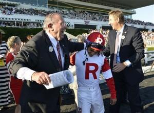 Ken Ramsey and jockey Alan Garcia celebrate their 2013 Arlington Million