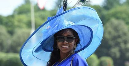 "The day's most popular category, ""Fashionably Saratoga,"" attracted a large number of contestants donning their most beautiful hats. Following the fourth race, Tonia Cooke of Huntington, NY, was named ""most fashionable"" and awarded a $100 Hatsational by DEI gift card. Photo: NYRA"