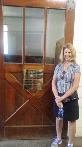 Author Mary Perdue in front of the most famous stall at Claiborne Farm in Kentucky, where Runhappy took up residence last month. Photo: Mary Perdue