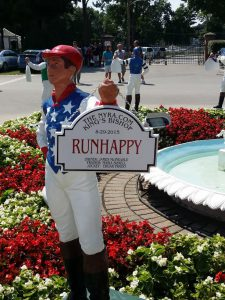 Runhappy silks on a Saratoga lawn jockey. Photo: Mary Perdue